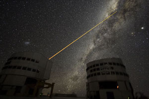 Laser beaming out from one of the VLT telescope.